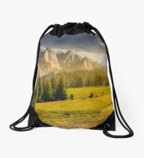 spruce trees on hillside in mountains at sunset Drawstring Bag