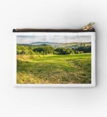 grassy rural field in mountains Studio Pouch