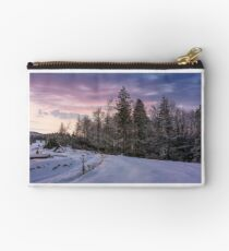 forest in hoarfrost on snowy hillside at dawn Studio Pouch