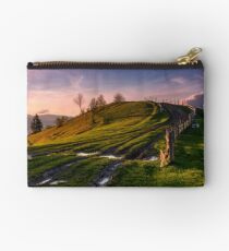fence along the country road uphill at dusk Studio Pouch