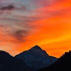 Stunning vibrant sunset behind mountain by Patrik Lovrin