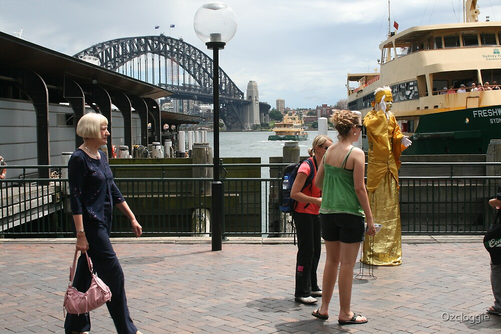 Tall lady, at Circular Quay, between the bridge and the opera house. by Ozcloggie