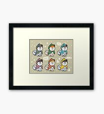 Husky puppies in coats Framed Print