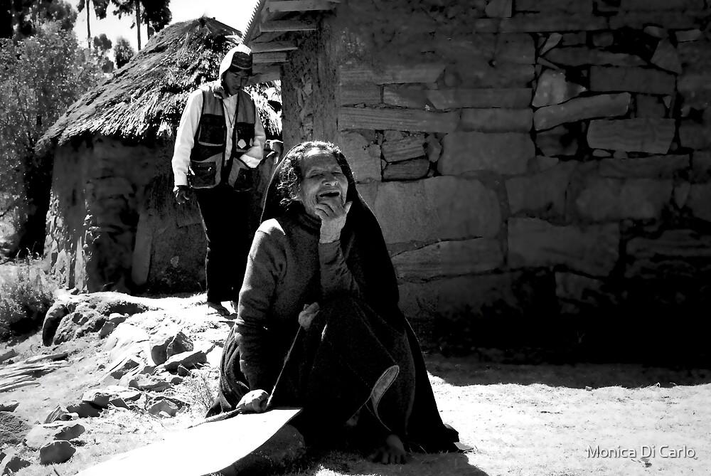 Man and woman on Titicaca Lake, Peru by Monica Di Carlo