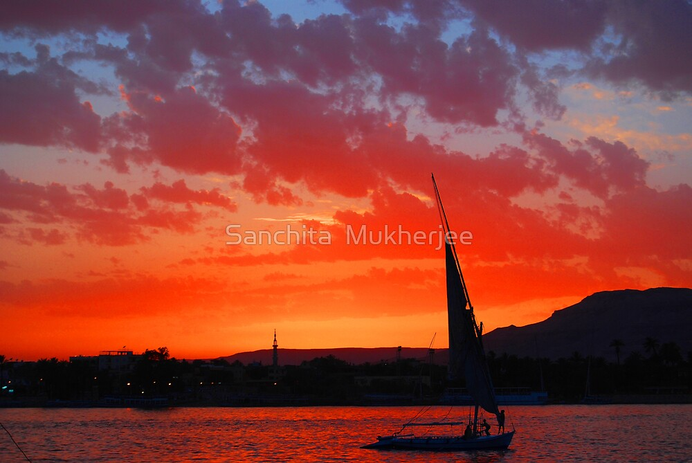 silhouette of a felluca and a mosque as the sun sets on the Nile by Sanchita  Mukherjee