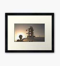 Sailing into the sun Framed Print