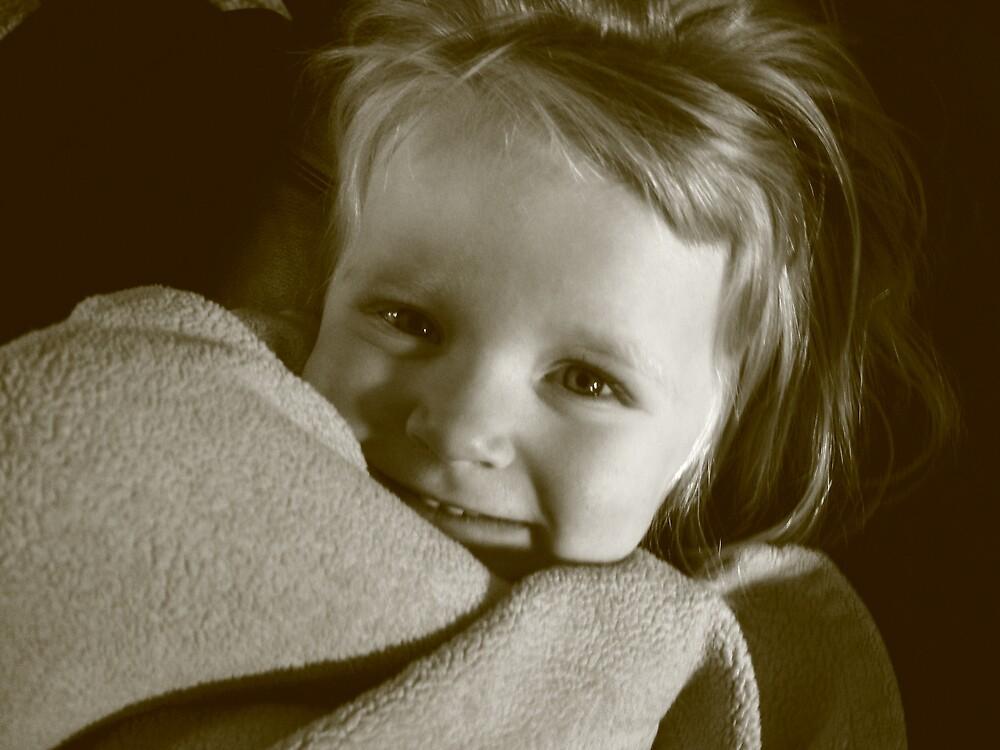 3 year old girl with blanket by Carolyn Crosby