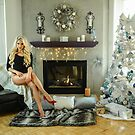 Luxury house Interior with fireplace,  Christmas tree and sexy blonde model sitting in the chair by Anton Oparin