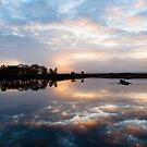 Pink and Blue Misty Sunrise Reflected in Loch Ba by Mark Greenwood