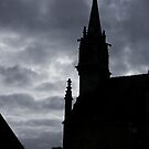 Brittany Church Silhouetted Against a Threatening Sky - France by Buckwhite
