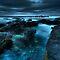 A dark, long-exposured ocean/rock scenery