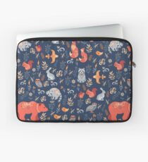 Fairy-tale forest. Fox, bear, raccoon, owls, rabbits, flowers and herbs on a blue background. Laptop Sleeve
