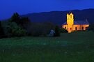 Franclens church illuminated at dusk by Patrick Morand
