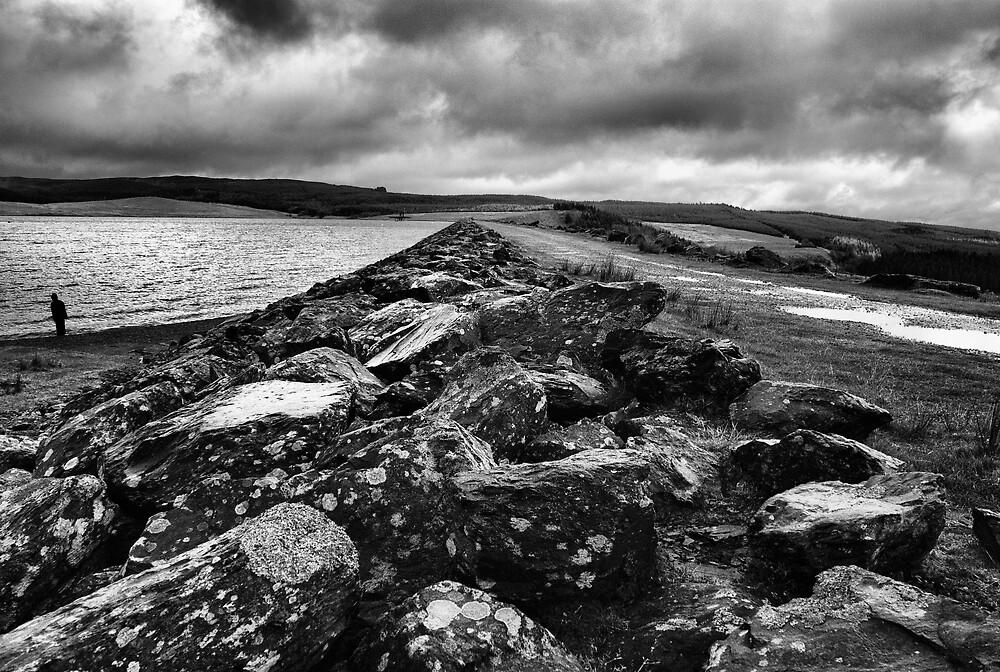 Lonely figure at Llyn Brenig by Julian MacDonald