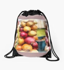 Decorative onions hanging on a string on a farmers market Drawstring Bag