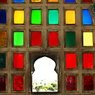 Colour glass window at Palace in Udaipur, Rajasthan by Bev Pascoe