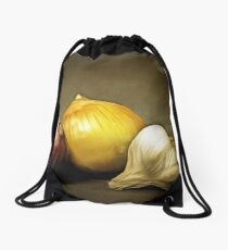 Still leben with red and yellow onion and a Garlic on brown backdrop Drawstring Bag
