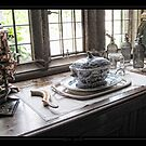 Things on the cabinet next to the window by Roberta Angiolani