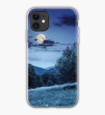 meadow near the forest in mountains at night  iPhone Case