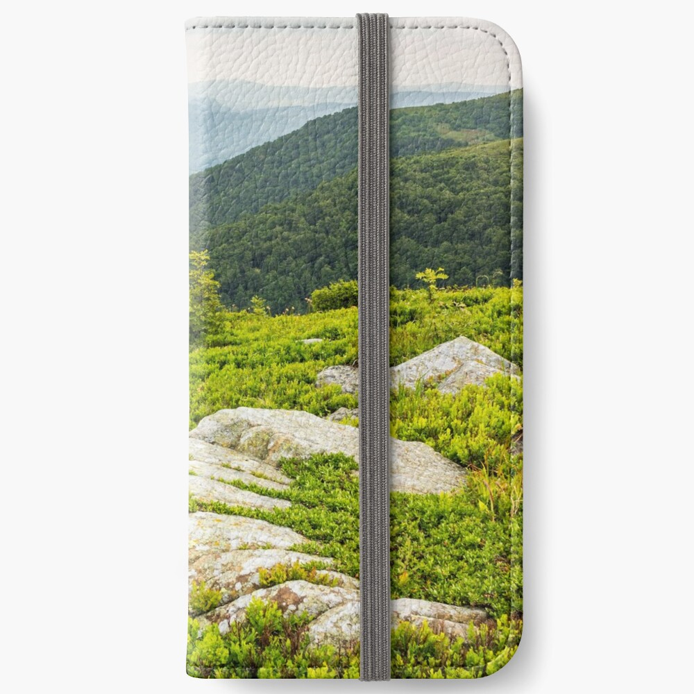 few trees and stones on hill side iPhone Wallet