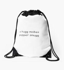 a hugg makes a pupper snugg Drawstring Bag