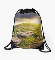white boulders on the hillside at sunset Drawstring Bag