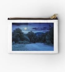 road through the forest in mountains at night Studio Pouch