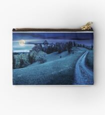 path to fortress ruins on hillside with forest at night Studio Pouch