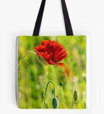 red poppy in the wheat field Tote Bag
