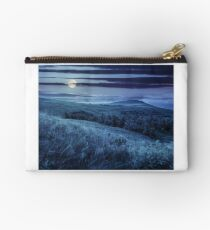 pine trees in mountain valley at night Studio Pouch