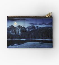 lake near the mountain in pine forest at night Studio Pouch