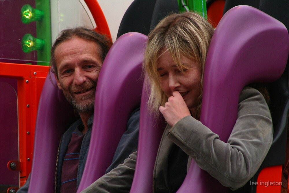 One happy and one scared fairground riders by lee ingleton