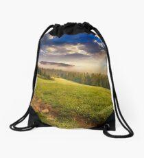 fog around the mountain top at sunset Drawstring Bag
