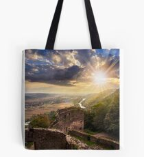 ruins of castle in mountain at sunset Tote Bag