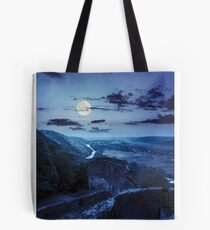 ruins of castle in mountain at night Tote Bag