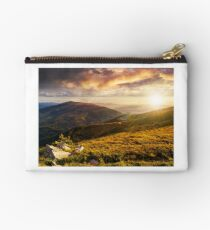 hillside with stones in high mountains at sunset Studio Pouch