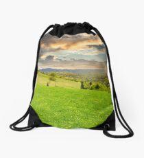 village on hillside meadow Drawstring Bag