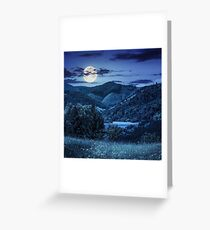 pine trees near meadow in mountains at night Greeting Card