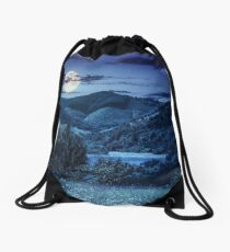 pine trees near meadow in mountains at night Drawstring Bag