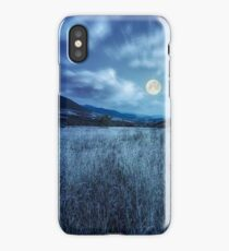 meadow with high grass in mountains at night iPhone Case