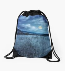 meadow with high grass in mountains at night Drawstring Bag
