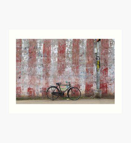 Bike against a temple wall. Kumbakonam, India Art Print