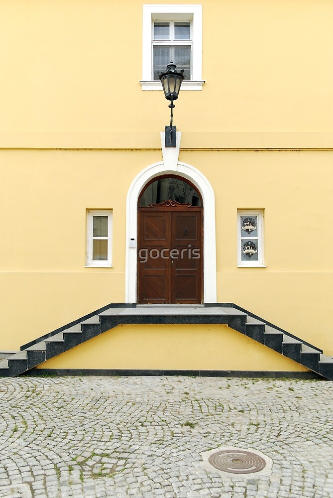 Old yellow house with staircase entrance by goceris