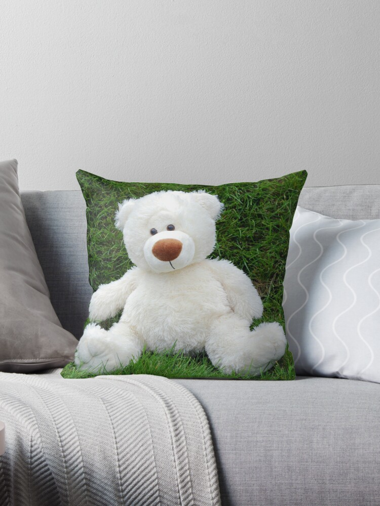 White teddy-bear sitting in grass by goceris