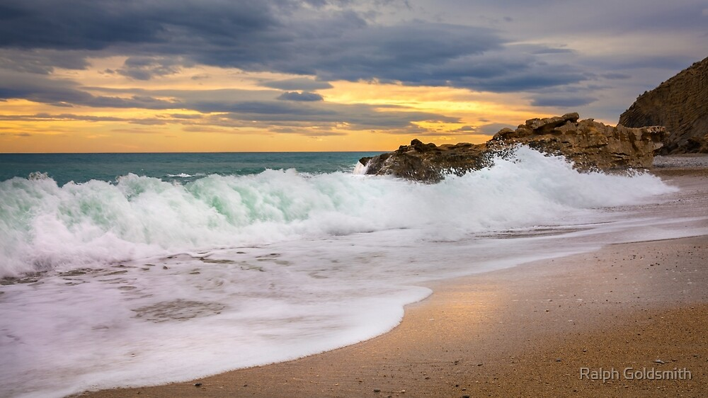 Waves on the rocks at Playa la Caleta by Ralph Goldsmith