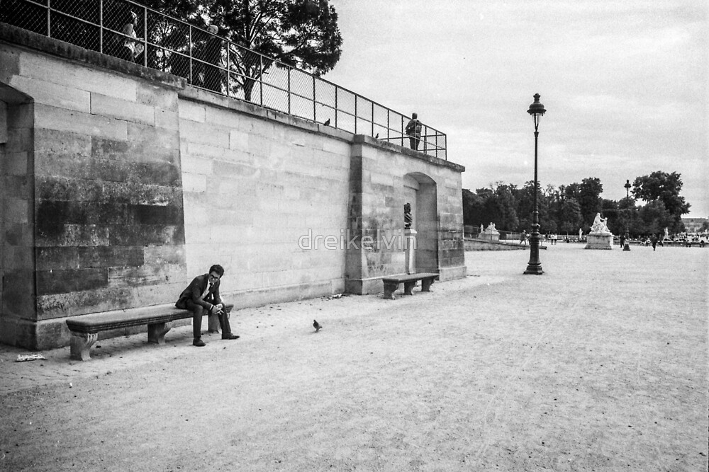 Stranger sitting at Place de la Concorde by dreikelvin