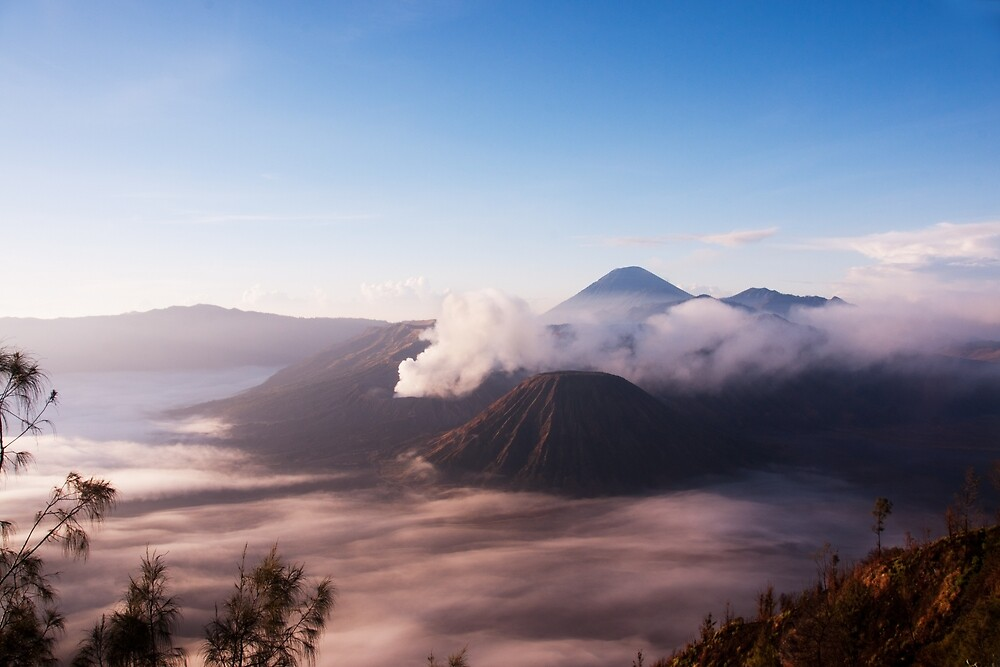 Mount Bromo and Batok surrounded by mist. by Eduard Todikromo