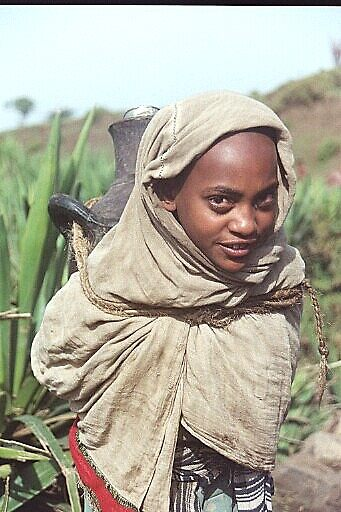 Young Woman Carrying Water in Ethiopia * by Laurel Talabere
