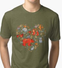 Fairy-tale forest. Fox, bear, raccoon, owls, rabbits, flowers and herbs on a blue background. Tri-blend T-Shirt