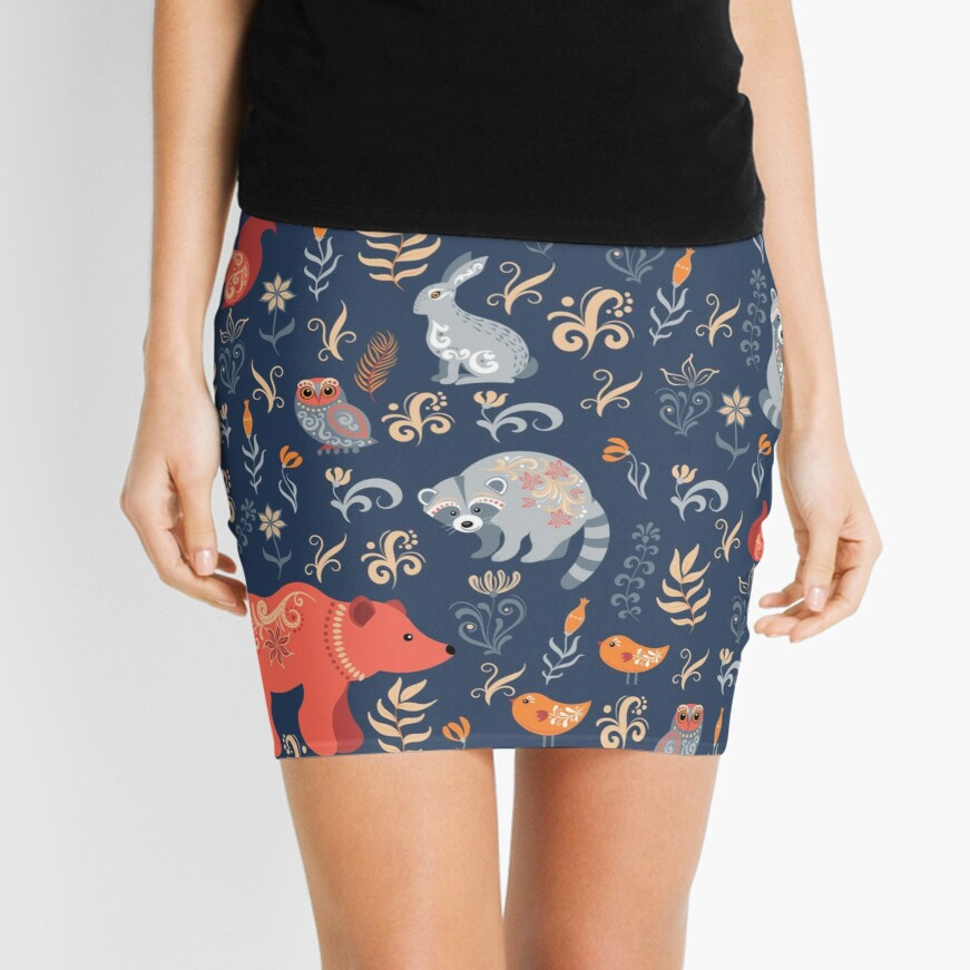 Fairy-tale forest. Fox, bear, raccoon, owls, rabbits, flowers and herbs on a blue background. Mini Skirt